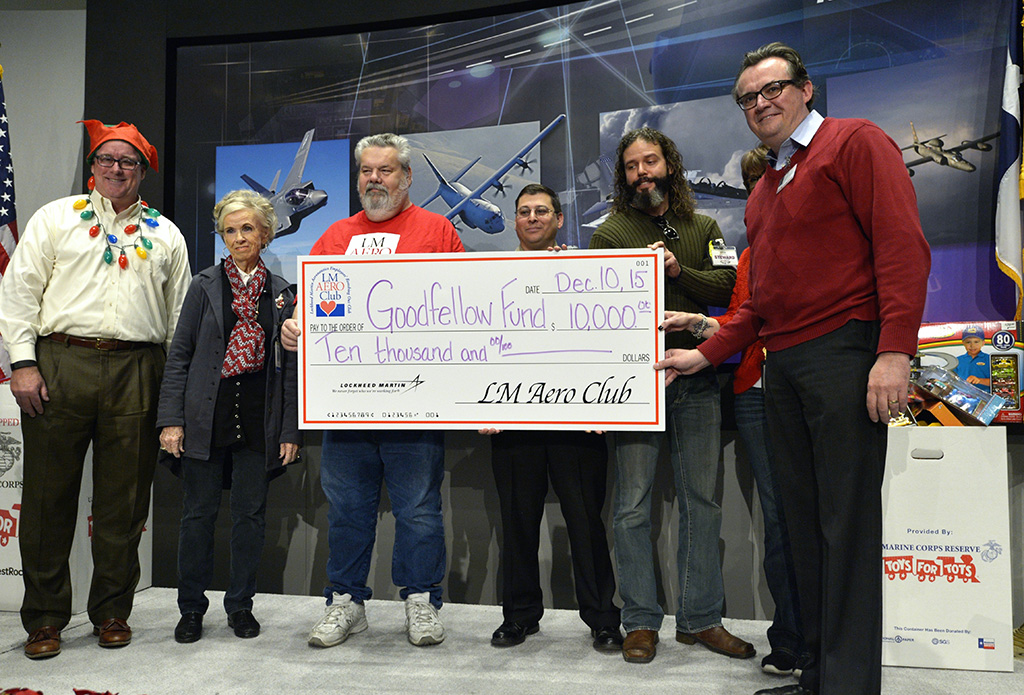 Fort Worth Star-Telegram Steve Kaskovich, Deputy Managing Editor / Business, accepts a $10,000 donation check for Goodfellows fund as Lockheed Martin employees gather more than 200 bicycles to donate to the Marine Corps Toys for Tots program at Lockheed Martin Aeronautics in Fort Worth, TX, Thursday, Dec. 10, 2015. The employees also presented checks totaling tens of thousands of dollars from employee donations to local community organizations.